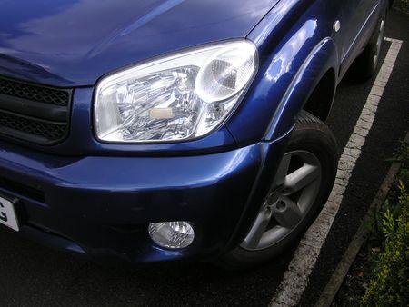 headlight of a blue car