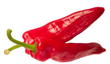 sumptious: two chilli peppers isolated over white