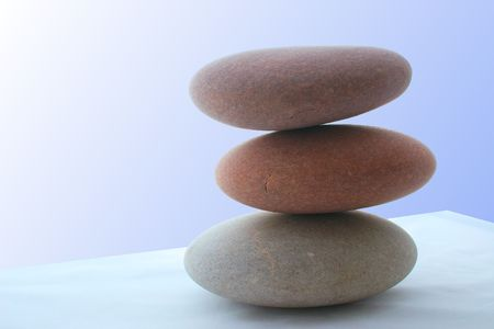 three: large flat stones against a blue background Stock Photo