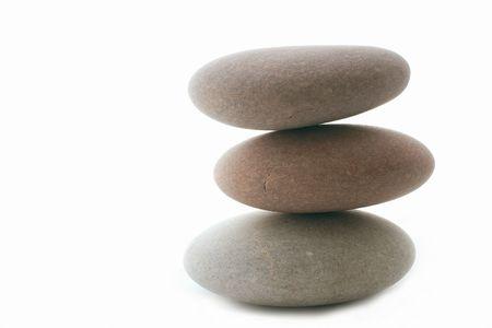 large flat stones against a white background Stock Photo