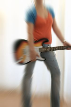 blurr: female guitarist playing electric guitar with radial blurr Stock Photo