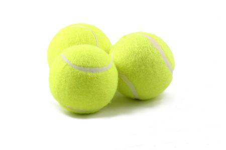 three tennis balls with a white background Stock Photo