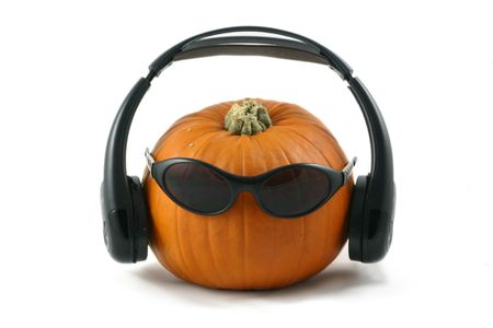 whole large pumpkin dressed as a dj with his headphones and dark glasses Stock Photo