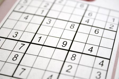 brainteaser: shallow focus sudoku puzzle  in a book Stock Photo