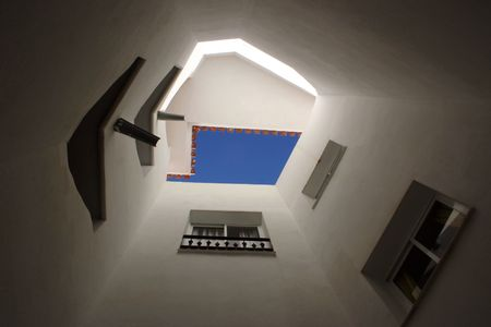looking up the inside of a tower of a residential structure Stock Photo - 720970