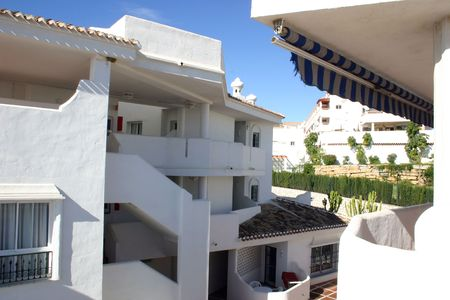 residential resort buildings showing the balconies and white walls