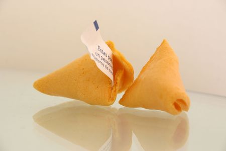 open fortune cookie with the slip of paper sticking out photo