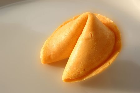 open fortune cookie with the slip of paper sticking out