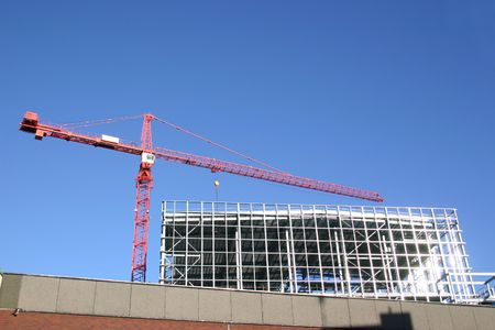 crane used for the construction of a building photo