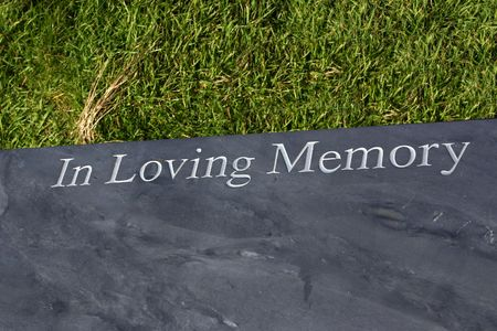 in loving memory: In loving memory, a slate seat set in a favourite place of the person