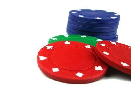 stacks of poker chips isolated overwhite