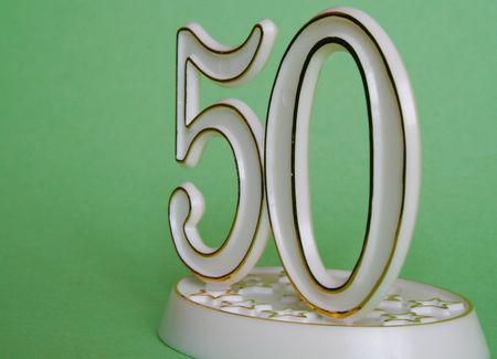 50th occasion sign over green Stock Photo
