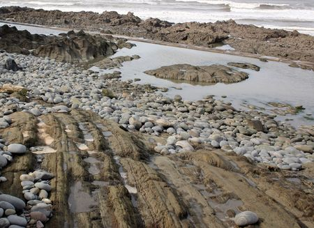 round shapes of rocks of a rugged seashore Stock Photo - 932581