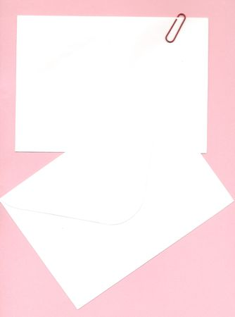 memo notepaper and envelope over pink photo