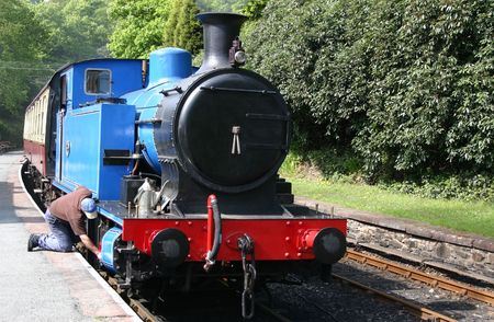 steam locomotive being checked by the driver Stock Photo - 970753