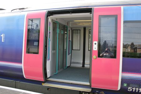 modern train: modern train carriage with the sliding doors open Stock Photo