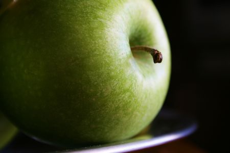 green apple take with natural light and a dark background Stock Photo - 1066642