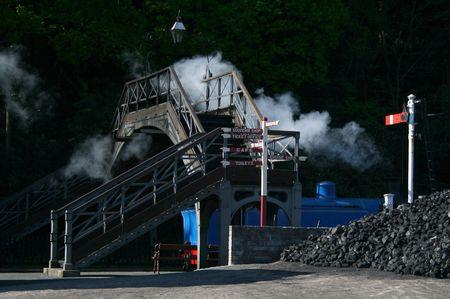 steam engine going under a old iron bridge Stock Photo - 1335495