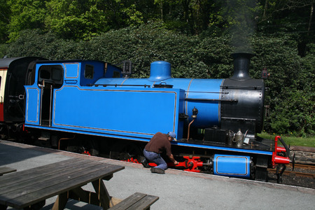 steam locomotive being checked by the driver Stock Photo - 1413173