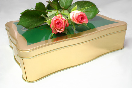 roses on a tin of chocolates over a light background Stock Photo - 1423889