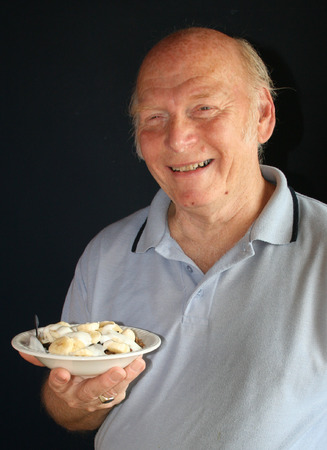 elderly man with his bowl of healthy breakfast cereal
