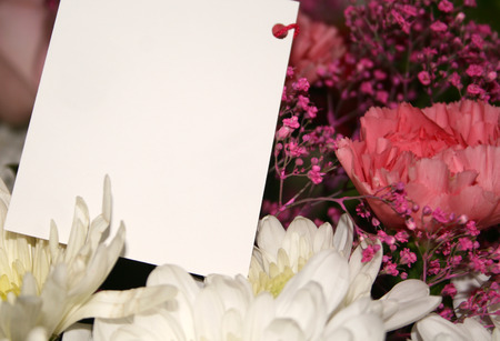 blank card on a bouquet of flowers   photo