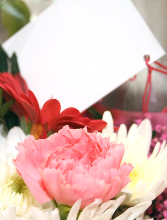 blank card on a bouquet of flowers