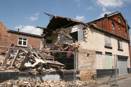 damaged roof: remains of a building which had collapsed