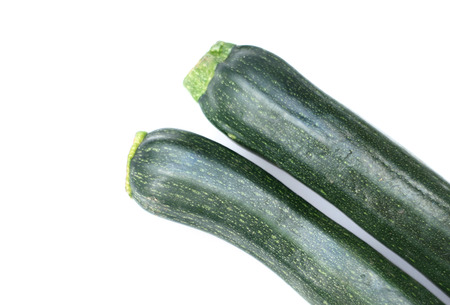 courgettes: two courgettes isolated over a white background Stock Photo