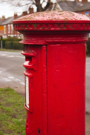 english red mailbox situated at the side of the road for public mail Stock Photo - 1944643