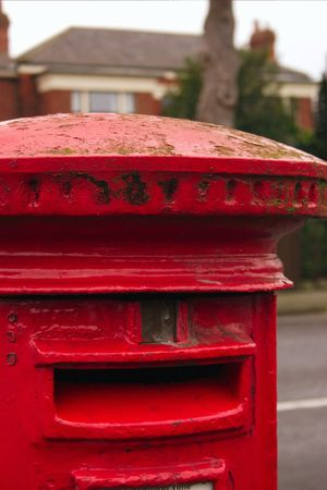 english red mailbox situated at the side of the road for public mail Stock Photo - 1944647