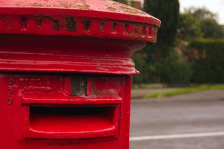 english red mailbox situated at the side of the road for public mail Stock Photo - 1944640