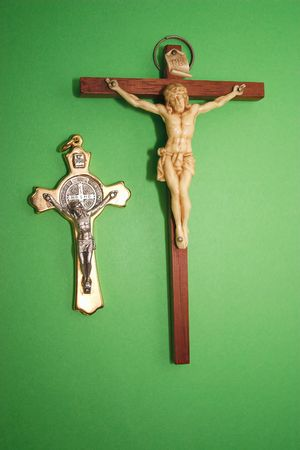 two different crucifixes over a green background Stock Photo - 1988601