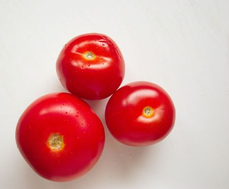 three fresh red tomatoes over a light background Stock Photo - 1988572