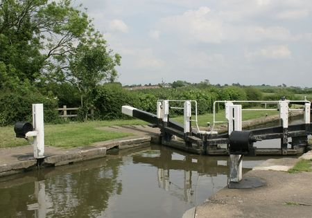 canal lock: canal lock gates holding the water in the lock