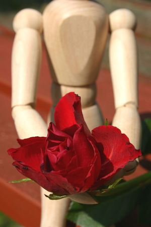 mannequin waiting to give his loved one a rose on valentines day photo