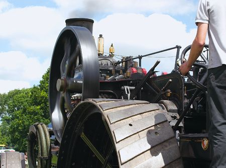 traction engine wheels  detail with the driver steering Stock Photo - 2080129