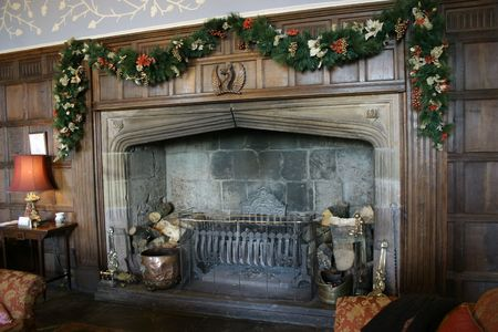 large majestic fireplace decorated for the christmas season Stock Photo