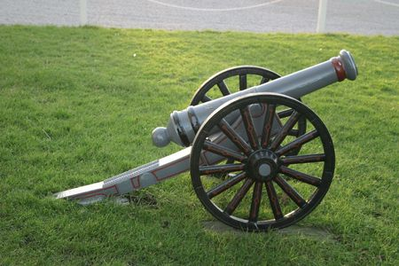 restored: old restored cannon outside on the grass