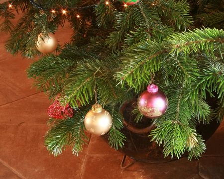 baubles hanging on the branches of a christmas tree Stock Photo - 2346769