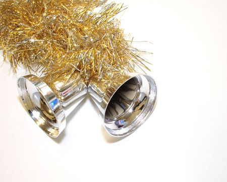 gold and silver tinsel with silver bells decorations for the christmas tree over a light background Stock Photo - 2419474
