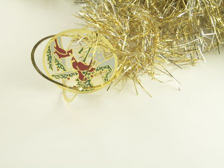 gold  tinsel with delicate  christmas decorations for hanging on the christmas tree isolated over white background Stock Photo - 2419471