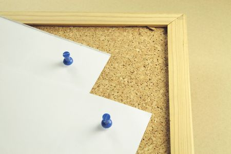 two pieces of white notepaper on a cork board background photo