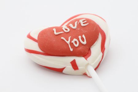 candy lolly with love you written on a red heart photo