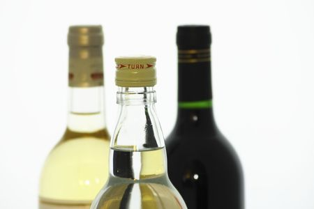 two bottles of unopened white and red wine and a bottle of vodka photo
