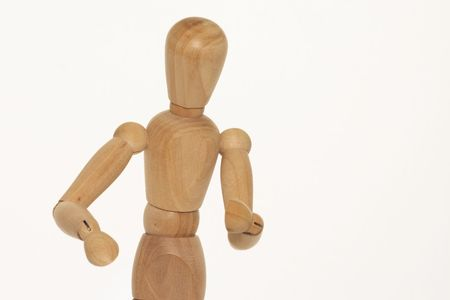 artists dummy: wooden mannequin against a light background