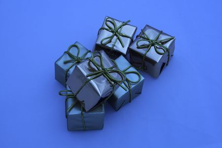 fastened: blue coloured boxed square presents fastened with bows