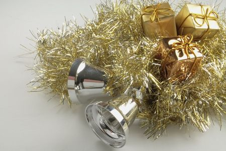 gold and silver tinsel tinsel with silver bells and gold presents objects for decorating the christmas tree isolated over a white background Stock Photo - 2827673
