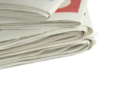 publishers: pile of daily newspapers isolated over a white background