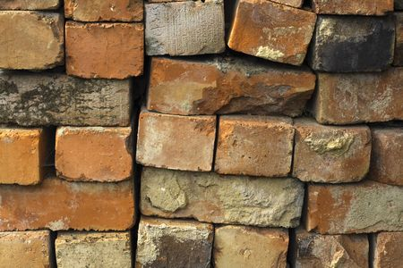 restored: reclaimed bricks stacked ready to be cleaned and used for rebuilds Stock Photo